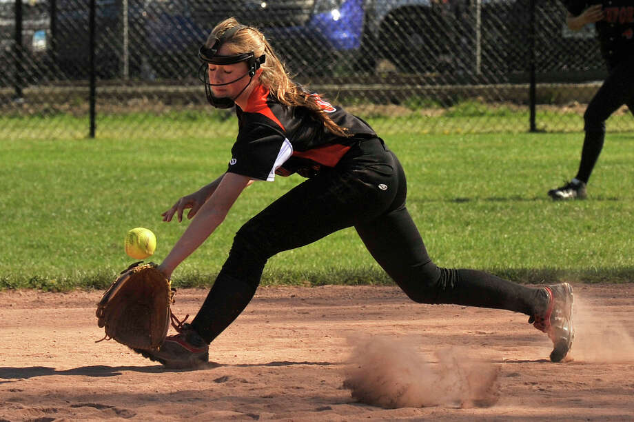 Stamford second baseman Gloria Mattioli reaches for a ball hit to the infield gap during the Black Knights' softball game against Fairfield Warde at Stamford High School in Stamford, Conn., on Friday, May 1, 2015. Stamford won, 3-0. Photo: Jason Rearick / Stamford Advocate