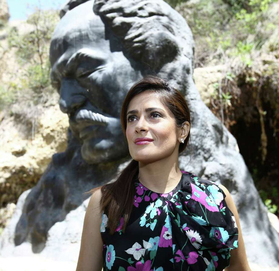 """A picture made available by the Salma Hayek Press Office shows the actress posing for a photo with the statue of Gibran Khalil Gibran outside his museum during a visit to promote her film """"The Prophet"""" in Gibran's hometown of Besharre, north of the Lebanese capital Beirut, on April 26, 2015. AFP PHOTO / HO / SALMA HAYEK PRESS OFFICE == RESTRICTED TO EDITORIAL USE / MANDATORY CREDIT: """"AFP PHOTO / HO / SALMA HAYEK PRESS OFFICE"""" - NO MARKETING - NO ADVERTISING CAMPAIGNS / DISTRIBUTED AS A SERVICE TO CLIENTS ==HO/AFP/Getty Images Photo: HO, Handout / AFP / Getty Images / AFP"""
