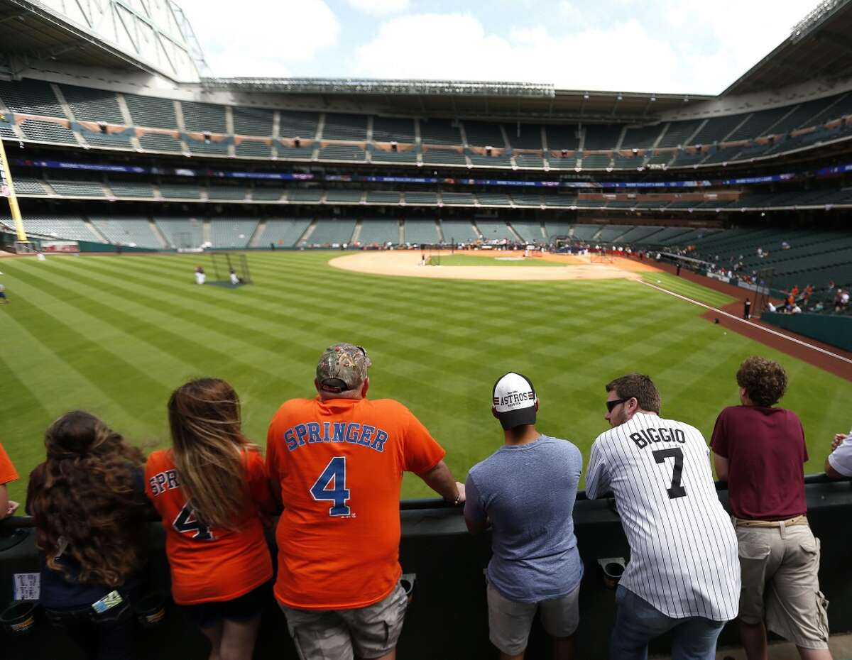 Houston Astros fans look to catch home run balls in the Crawford Boxes during batting practice before the start of the Opening Day MLB game at Minute Maid Center on Monday, April 6, 2015, in Houston. ( Karen Warren / Houston Chronicle )