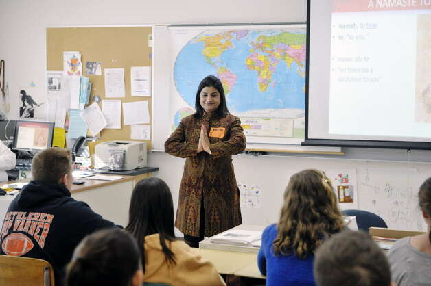 Teacher Reena Paliwal from India shows students how people greet each other in her country during a talk at Bethlehem Middle School on Tuesday, Feb. 24, 2015, in Bethlehem, N.Y. Paliwal is part of a group of teachers from around the globe taking part in a teaching program at the College of Saint Rose. (Paul Buckowski / Times Union)