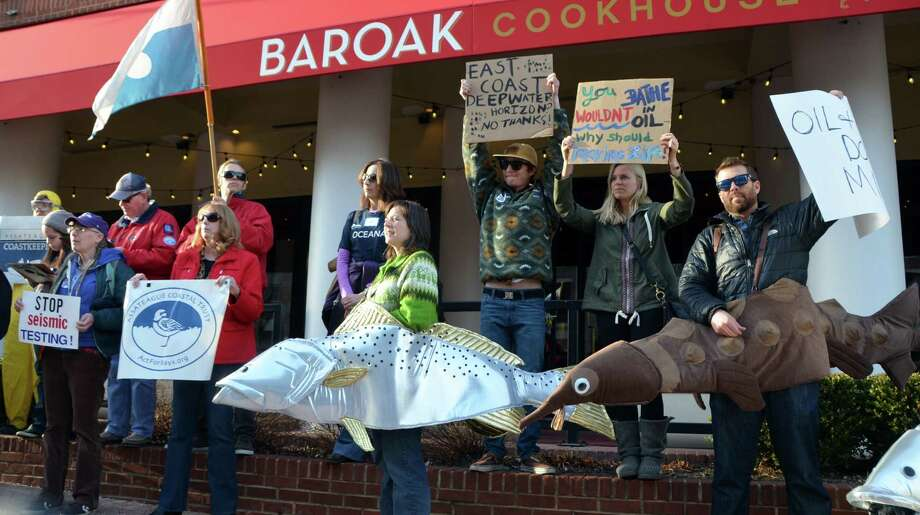 Offshore drilling protesters rally against proposed oil and gas leasing along the East Coast during a public meeting last month in Annapolis, Md. The Interior Department's draft plan for 2017 to 2022 proposes 14 offshore oil and gas lease sales, with 10 in the Gulf of Mexico, three in waters near Alaska and one targeting Atlantic waters near Virginia, North Carolina, South Carolina and Georgia. Photo: Jennifer A. Dlouhy /Houston Chronicle / Houston Chronicle