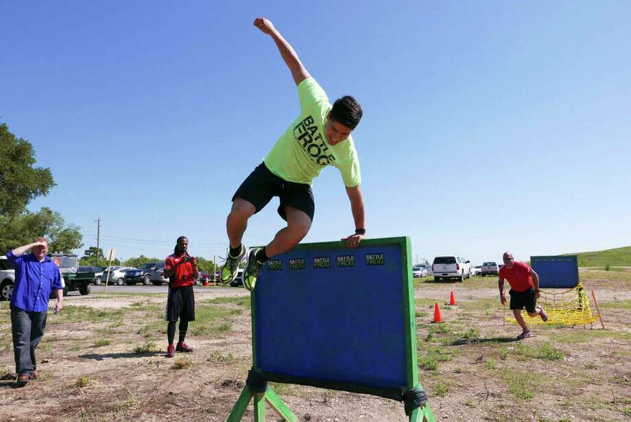 City councilman Rey Saldana runs an obstacle course during an event on Friday, May 1, 2015 to unveil improvements to the 500-acre Pearsall Park, which can now host 5 and 10k races, obstacle courses and half marathons. Photo: Billy Calzada, Staff / San Antonio Express-News / San Antonio Express-News
