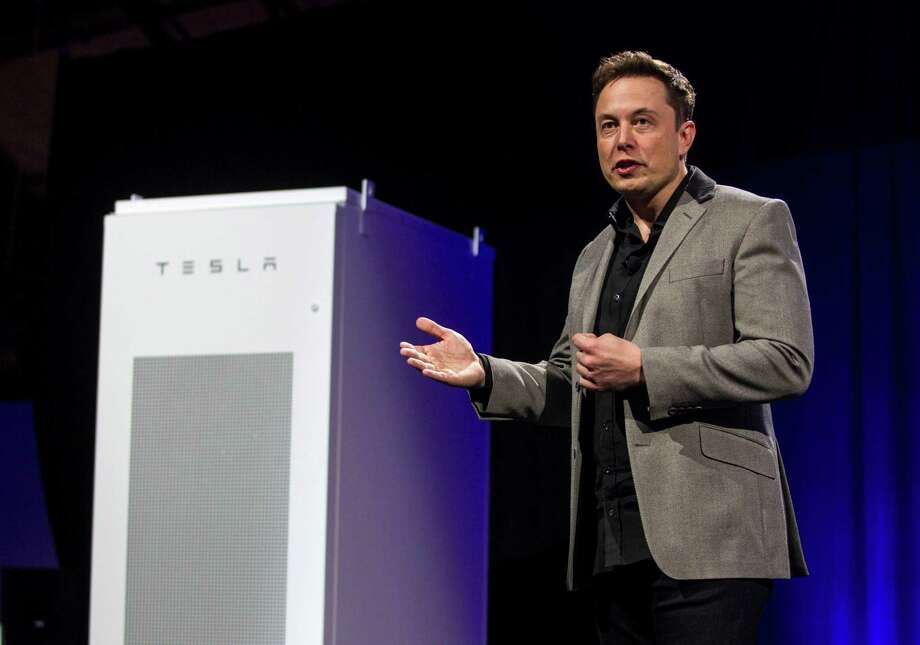 Elon Musk, CEO of Tesla Motors Inc., unveils the Powerpack. The home version increases a household's solar capacity. Photo: Ringo H.W. Chiu /Associated Press / FR170512 AP