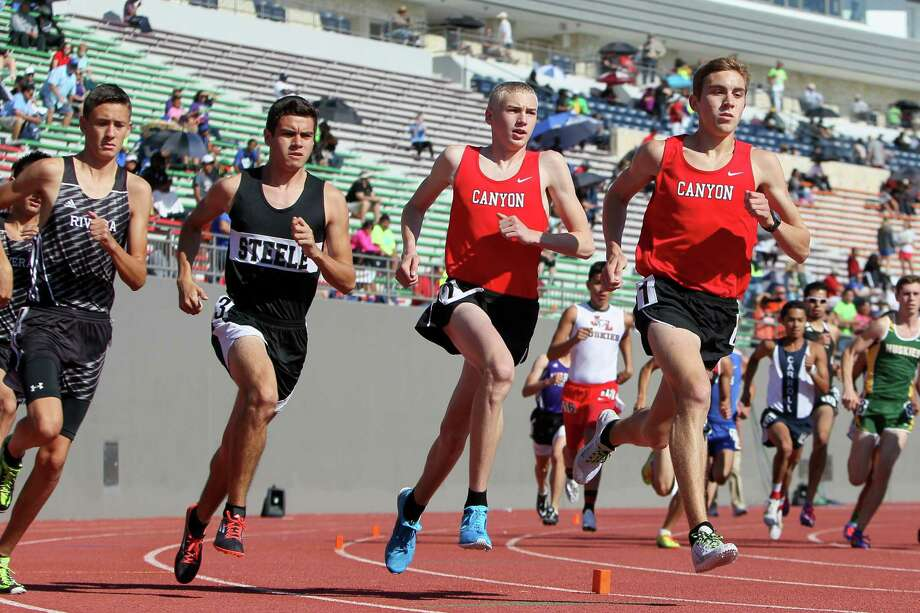New Braunfels Canyon's Sam Worley (from left) and Alex Rogers compete in the 3,200-meter run at the Region IV-6A meet at Alamo Stadium. Rogers won in a regional-record 9:00.60. Photo: Marvin Pfeiffer /San Antonio Express-News / Express-News 2015