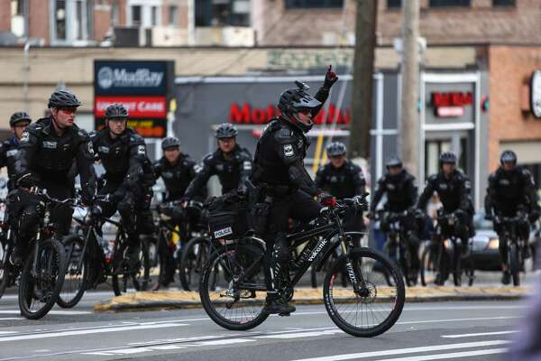 """Police gather on Seattle's Capitol Hill  as """"anti-capitalist"""" May Day protesters prepare for an unpermitted march on May 1, 2015."""