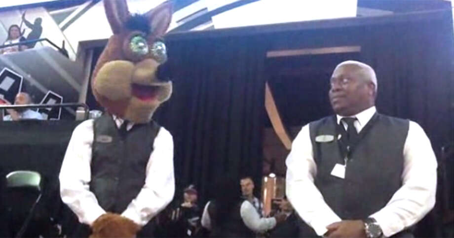 The Spurs Coyote and the Spurs Dancing Usher Eric Byrd prepare to face off in a dance battle for the ages during Game 6 of the first round of the Western Conference NBA Playoffs between the Spurs and the Los Angeles Clippers at the AT&T Center.Click ahead to see more photos of the Spurs Dancing Usher, and 22 things you should know about the Spurs Coyote. Photo: Hector Saldana/San Antonio Express-News