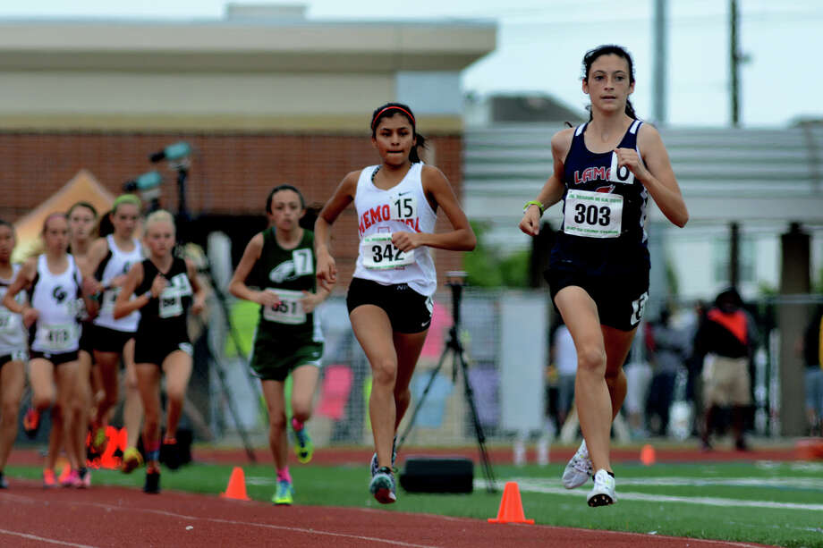 Lamar sophomore Julia Heymach (303) has a comfortable lead en route to winning the 3,200 meters at the Class 6A Region III meet and qualifying for state. Photo: Jerry Baker, Freelance