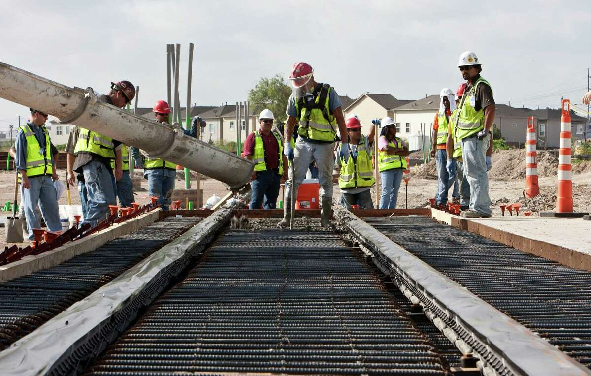 METRORail pours first concrete for the Southeast (Purple) line at the intersection of Paige and Rusk Wednesday, Aug. 10, 2011, in Houston. ( James Nielsen / Chronicle )