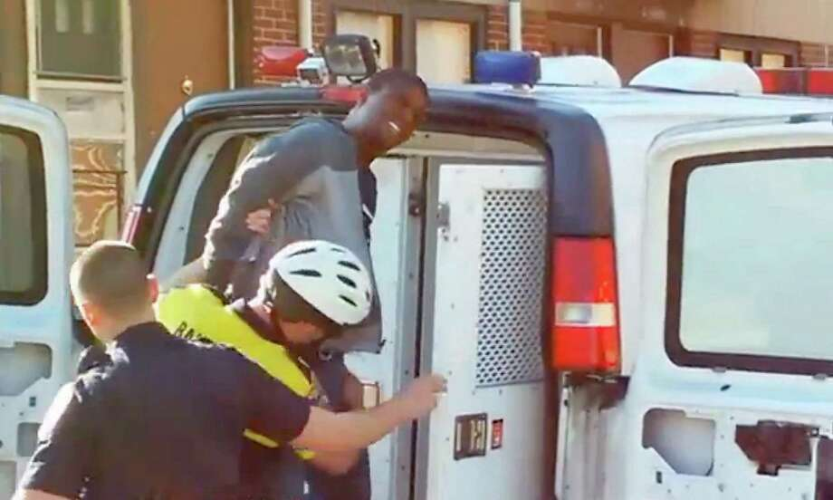 Freddie Gray is seen being taken into custody by Baltimore Police on April 12 in this still from a cell phone video. (Baltimore Sun) Photo: Handout /McClatchy-Tribune News Service / Baltimore Sun