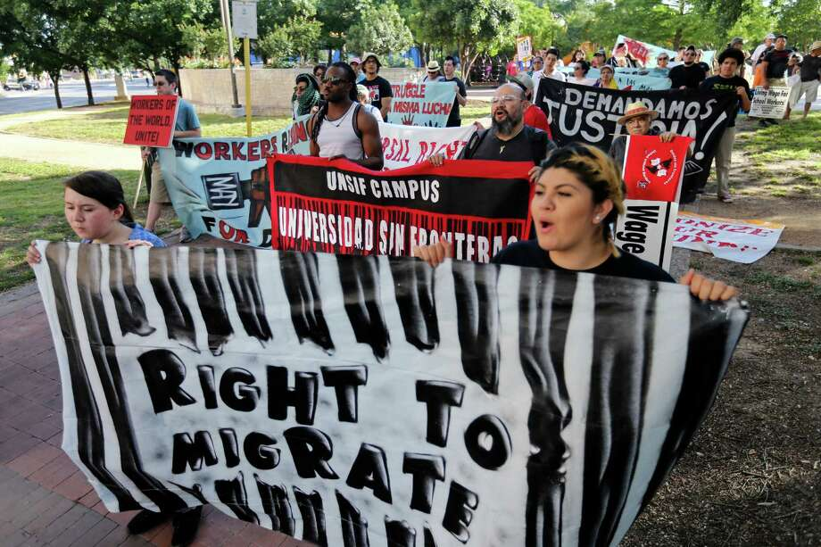 People gather for the International Workers Day march Friday May 1, 2015 at Milam Park. About 50 people took part in the march through downtown. Photo: Edward A. Ornelas, Staff / San Antonio Express-News / © 2015 San Antonio Express-News