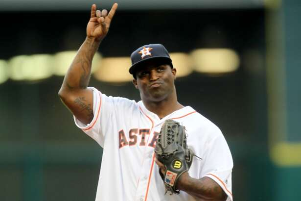 Ricky Williams, former University of Texas Longhorn and NFL player, throws out the first pitch before the start of  a baseball game between the Houston Astros and Seattle Mariners at Minute Maid Park Friday, May 1, 2015, in Houston. ( Gary Coronado / Houston Chronicle )