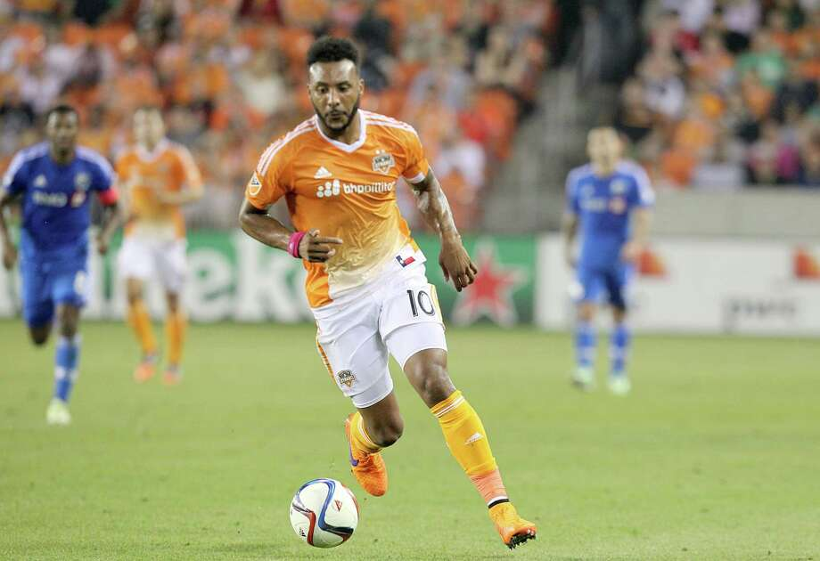 Houston Dynamo forward Giles Barnes (10) dribbles against the Montreal Impact in the first half at BBVA Stadium on Saturday, April 11, 2015 in Houston, TX.  (Photo: Thomas B. Shea/For the Chronicle) Photo: Thomas B. Shea, Freelance / © 2015 Thomas B. Shea