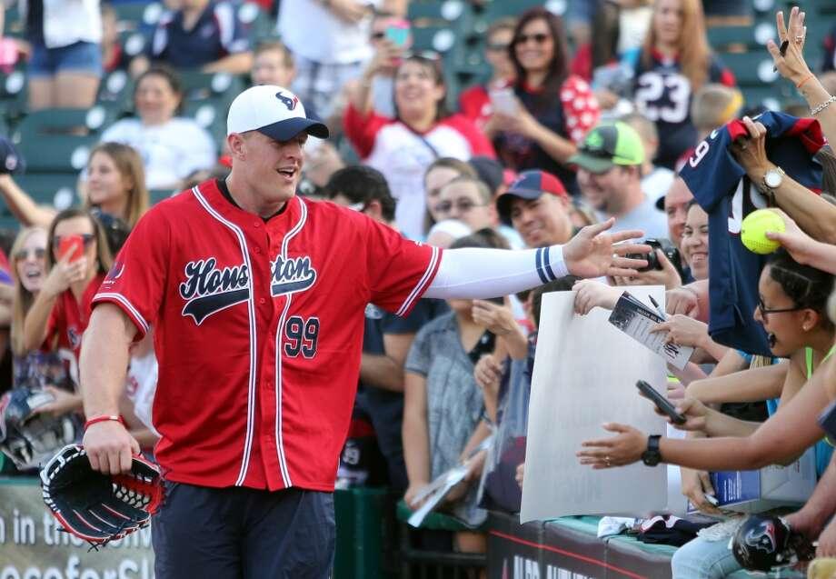 J.J. Watt greets his fans at the start of the J.J. Watt Charity Classic at Constellation Field on Friday, May 1, 2015, in Sugar Land. ( Mayra Beltran / Houston Chronicle ) Photo: Houston Chronicle