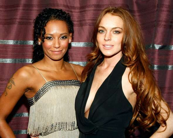 "LAS VEGAS - APRIL 18:  *EXCLUSIVE ACCESS* Singer Melanie Brown (L) and actress Lindsay Lohan appear in Brown's dressing room before the world premiere of the adult production ""PEEPSHOW"" at the Planet Hollywood Resort & Casino April 18, 2009 in Las Vegas, Nevada.  (Photo by Ethan Miller/Getty Images for BASE Entertainment) *** Local Caption *** Melanie Brown;Lindsay Lohan Photo: Ethan Miller, Getty Images For BASE Entertainm / 2009 Getty Images"