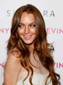 SANTA MONICA, CA - APRIL 30:  Actress Lindsay Lohan arrives at the launch of Sevin Nyne By Lindsay Lohan held at Sephora on April 30, 2009 in Santa Monica, California.  (Photo by Michael Buckner/Getty Images) *** Local Caption *** Lindsay Lohan Photo: Michael Buckner, Getty Images / 2009 Getty Images