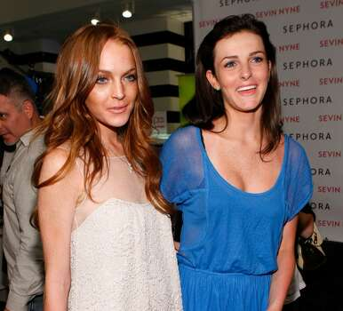SANTA MONICA, CA - APRIL 30:  Actress Lindsay Lohan and sister Ali Lohan attend the launch of Sevin Nyne By Lindsay Lohan held at Sephora on April 30, 2009 in Santa Monica, California.  (Photo by Michael Buckner/Getty Images) *** Local Caption *** Lindsay Lohan;Ali Lohan Photo: Michael Buckner, Getty Images / 2009 Getty Images