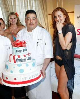 LAS VEGAS - JUNE 27:  Actress Lindsay Lohan is presented with a birthday cake as she appears at the Wet Republic pool at the MGM Grand Hotel/Casino to celebrate her birthday and her Sevin Nyne brand tanning mist June 27, 2009 in Las Vegas, Nevada. Lohan turns 23 on July 2.  (Photo by Ethan Miller/Getty Images for Wet Republic) *** Local Caption *** Lindsay Lohan Photo: Ethan Miller, Getty Images For Wet Republic / 2009 Getty Images