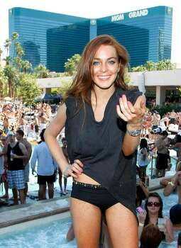 LAS VEGAS - JUNE 27:  Actress Lindsay Lohan appears at the Wet Republic pool at the MGM Grand Hotel/Casino as she celebrates her birthday and her Sevin Nyne brand tanning mist June 27, 2009 in Las Vegas, Nevada. Lohan turns 23 on July 2.  (Photo by Ethan Miller/Getty Images for Wet Republic) *** Local Caption *** Lindsay Lohan Photo: Ethan Miller, Getty Images For Wet Republic / 2009 Getty Images