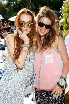 MALIBU, CA - JULY 11:  Actress Lindsay Lohan (L) and designer Dani Stahl attend the Lia Sophia Clam Bake at a private residence on July 11, 2009 in Malibu, California.  (Photo by Michael Buckner/Getty Images) *** Local Caption *** Lindsay Lohan;Dani Stahl Photo: Michael Buckner, Getty Images / 2009 Getty Images