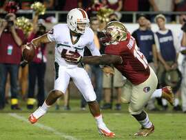 Florida State defensive end Mario Edwards Jr. (15) sacks Miami quarterback Stephen Morris (17) during the second quarter of an NCAA college football game Saturday, Nov. 2, 2013, in Tallahassee, Fla. (AP Photo/Steve Cannon)