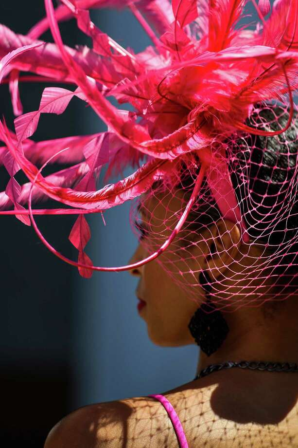 Chrystal Hawkins watches a race on Kentucky Oaks Day, the day before the Derby, at Churchill Downs in Louisville, Ky., May 1, 2015. Photo: WILLIAM DESHAZER, New York Times / NYTNS
