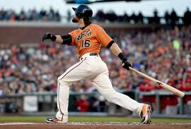 SAN FRANCISCO, CA - MAY 01:  Angel Pagan #16 of the San Francisco Giants hits a sacrifice fly scoring Nori Aoki #23 against the Los Angeles Angels of Anaheim in the bottom of the first inning at AT&T Park on May 1, 2015 in San Francisco, California.  (Photo by Thearon W. Henderson/Getty Images)