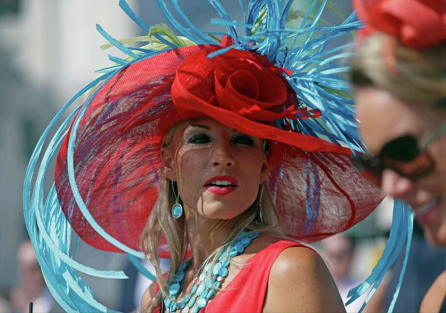 A woman wears a hat before the 141st running of the Kentucky Derby horse race at Churchill Downs Saturday, May 2, 2015, in Louisville, Ky. Photo: Brynn Anderson, AP / AP