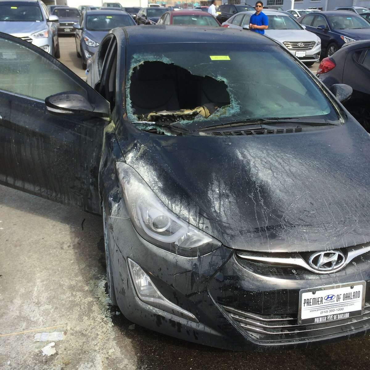 A burned-out Hyundai at a dealership on Broadway in Oakland. Vandals in a May Day march damaged dozens of cars at dealerships on Auto Row on May 1, 2015