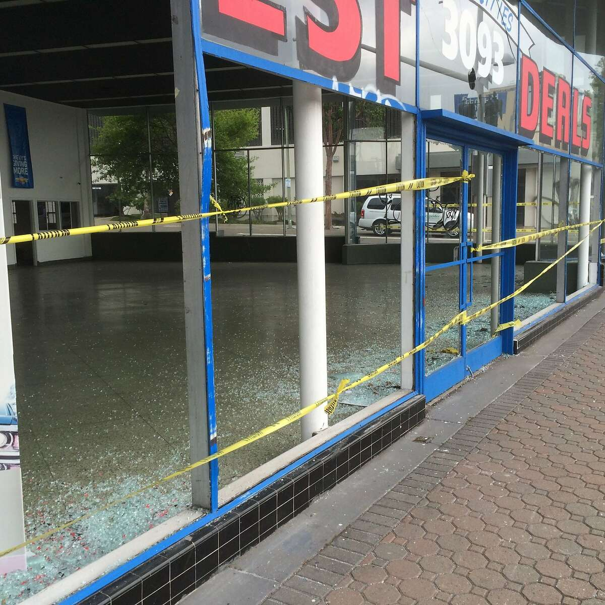 Smashed windows at a car dealership on Broadway at Hawthorne Avenue in Oakland. Vandals in a May Day march damaged dozens of cars at dealerships on Auto Row on May 1, 2015.