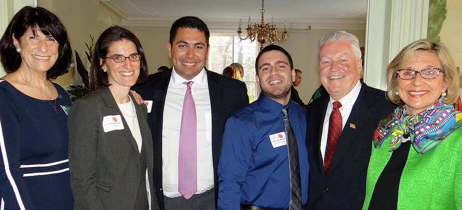 Enjoying the annual Spring Fling fundraiser sponsored by the Fairfield Chamber of Commerce were, from left, Beverly Balaz, the chamber's executive director; state Rep. Cristin McCarthy Vahey; Sacred Heart University students Ryan Coghill and Chris Mendoza; First Selectman Mike Tetreau, and Sheryl Shaughnessey of Shaugnessey Banks Funeral Home. Photo: Mike Lauterborn / Fairfield Citizen