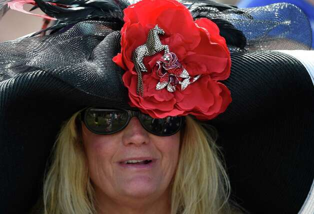 Pam Callan has the perfect hat Saturday May 2, 2015 at Churchill Downs in Louisville, Kentucky.  The 141st running of the Kentucky Derby post time is 6:34 this evening.    (Skip Dickstein/Times Union) Photo: SKIP DICKSTEIN