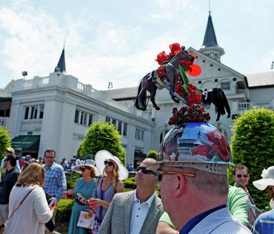 Skip Koepnick of Wyoming MI wears an interesting Derby hat Saturday May 2, 2015 at Churchill Downs in Louisville, Kentucky.  The 141st running of the Kentucky Derby post time is 6:34 this evening.    (Skip Dickstein/Times Union) Photo: SKIP DICKSTEIN