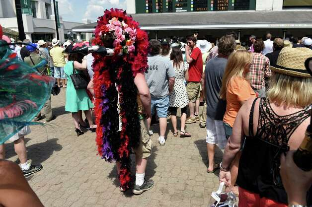 A very unusual headdress Saturday May 2, 2015 at Churchill Downs in Louisville, Kentucky.  The 141st running of the Kentucky Derby post time is 6:34 this evening.    (Skip Dickstein/Times Union) Photo: SKIP DICKSTEIN