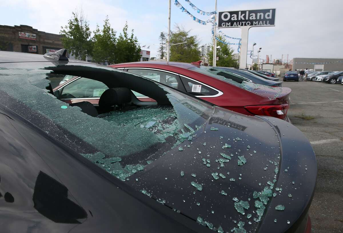 Windows of new Hyundai sedans are smashed in Oakland, Calif. on Saturday, May 2, 2015 after a demonstration turned violent Friday night. More than 40 new cars parked in a dealership storage lot were heavily damaged or destroyed and windows were smashed at several businesses along the Broadway corridor.