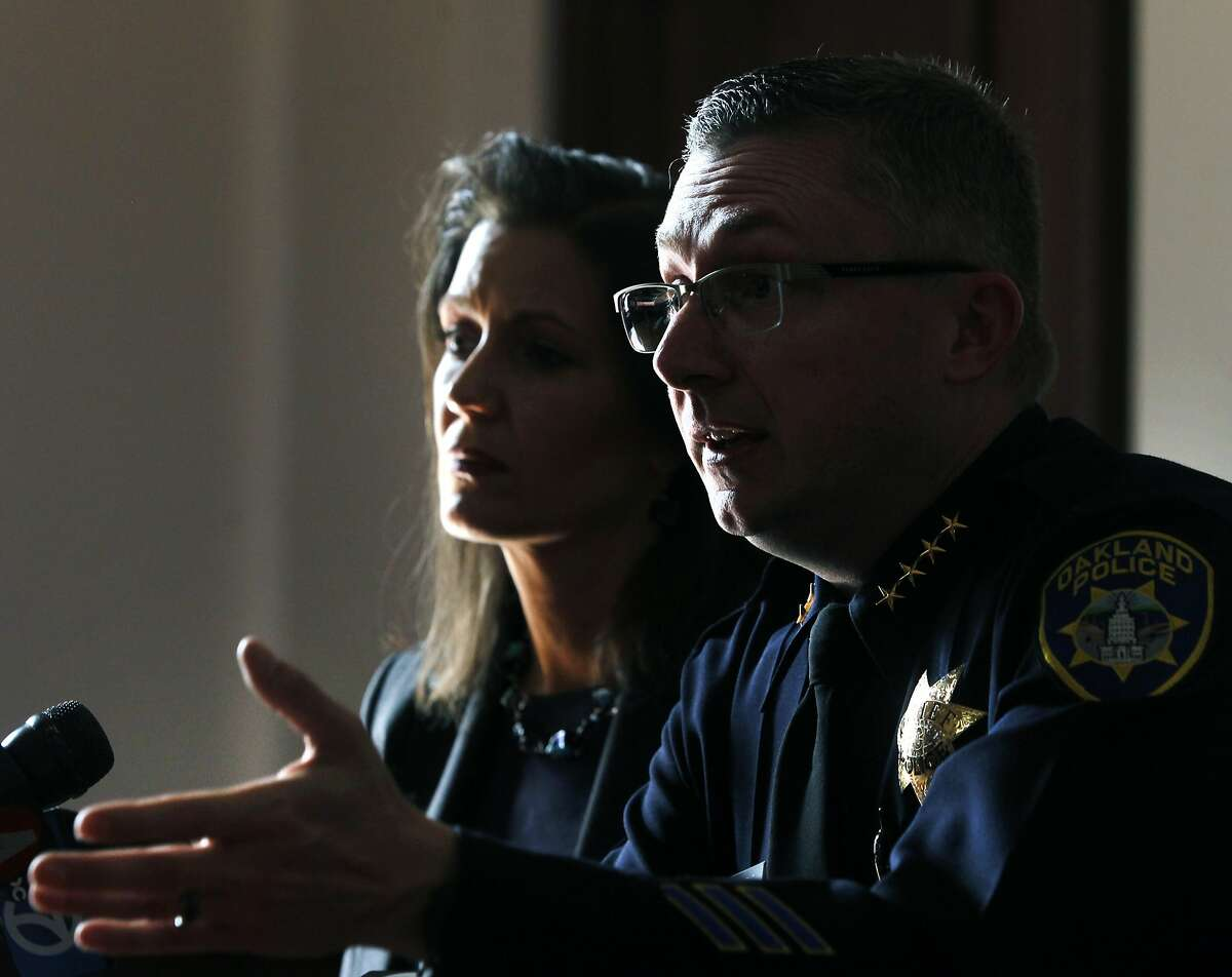 Police Chief Sean Whent and Mayor Libby Schaaf react to overnight violence during a news conference at City Hall in Oakland, Calif. on Saturday, May 2, 2015 after a demonstration turned violent Friday night. More than 40 new cars parked in a dealership storage lot were heavily damaged or destroyed and windows were smashed at several businesses along the Broadway corridor.