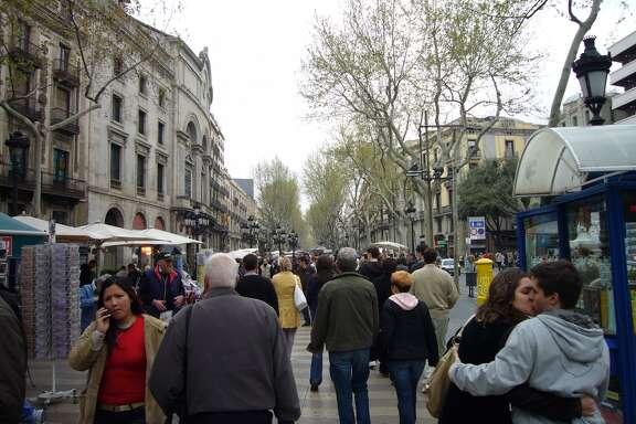 A couple kisses in public on Barcelona's Las Ramblas: a sign of a primo public space.