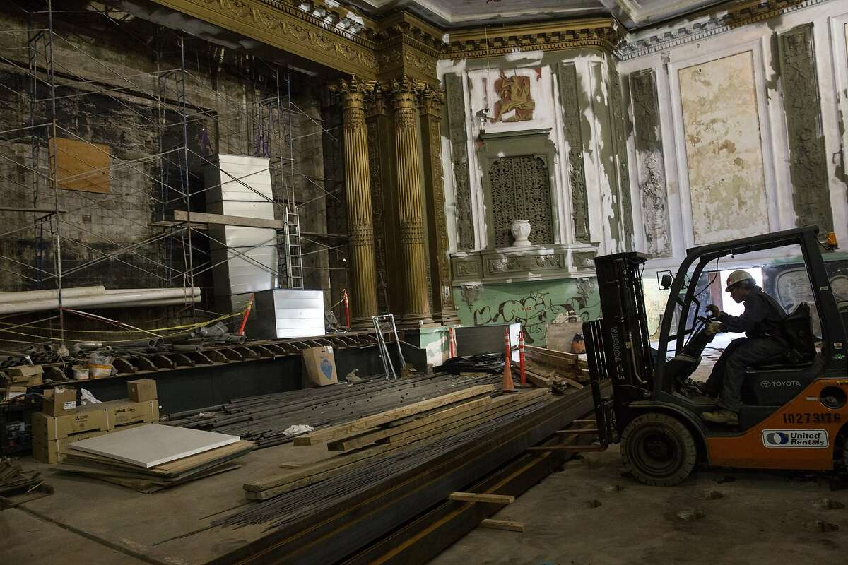 Construction crews work on the Alamo Drafthouse Cinema at the site of the former New Mission Theater on Mission Street between 21st and 22nd Streets in San Francisco, CA on May 1, 2015. The theater plans to open before the end of 2015.