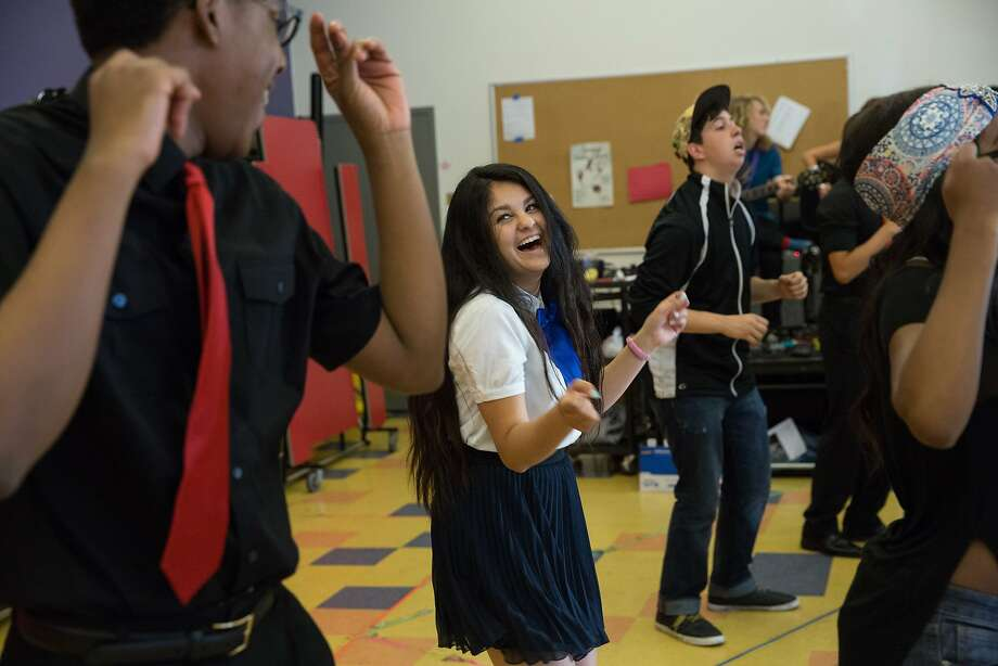 Oakland School for the Arts students and Members of the A Cappella group, Vocal Rush, William David Southall, 17, left, and Ari Nikbakht, 16, middle, and other students, participate in a rehearsal on Friday May 1, 2015, for an up coming performance called Caravan to take place at the Fox theater in Oakland on May 8, 2015. Photo: Erin Lubin, Special To The Chronicle