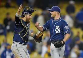 San Diego Padres catcher Derek Norris, left, celebrates with relief pitcher Craig Kimbrel after they defeated the Los Angeles Dodgers 7-3 in a baseball game, Tuesday, April 7, 2015, in Los Angeles. (AP Photo/Mark J. Terrill)