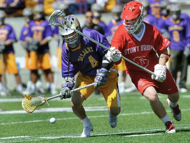 UAlbany's Lyle Thompson, left, and against Stony Brook's Andrew Dorsey battle for a loose ball in the America East Conference championship lacrosse game on Saturday, May 2, 2015, at Bob Ford Field in Albany, N.Y. (Cindy Schultz / Times Union) Photo: Cindy Schultz / 00031627A