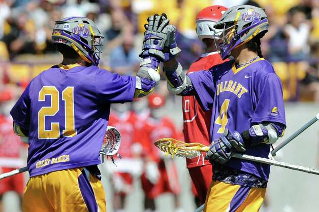 UAlbany's Seth Oakes, left and Lyle Thompson celebrate a goal in the America East Conference championship lacrosse game against Stony Brook on Saturday, May 2, 2015, at Bob Ford Field in Albany, N.Y. (Cindy Schultz / Times Union) Photo: Cindy Schultz / 00031627A