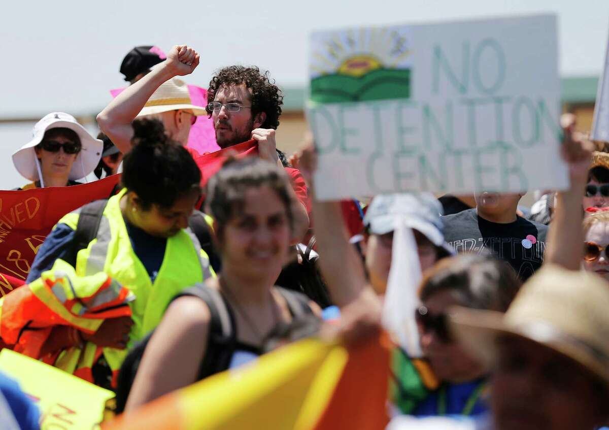 A young man who did not want to be identified joins hundreds during the immigration detention march and protest in Dilley, Texas on Saturday, May 2, 2015. (Kin Man Hui/San Antonio Express-News)