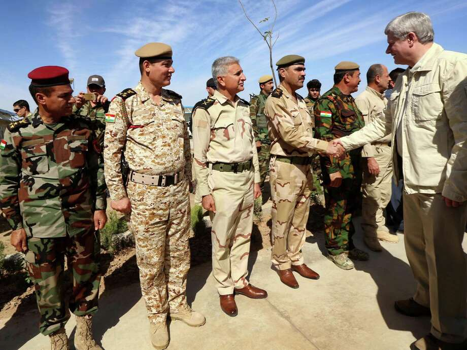 Canadian Prime Minister Stephen Harper greets Iraqi Kurdish forces on the front line in Khazer. Photo: Safin Hamed /Getty Images / AFP