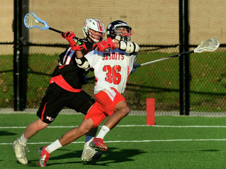 Fairfield Prep's Matthew Crowe winds up for a goal shot attempt as New Canaan's James Crovatto rushes to block, during boys lacrosse action at Fairfield University in Fairfield, Conn., on Saturday May 2, 2015. Photo: Christian Abraham / Connecticut Post
