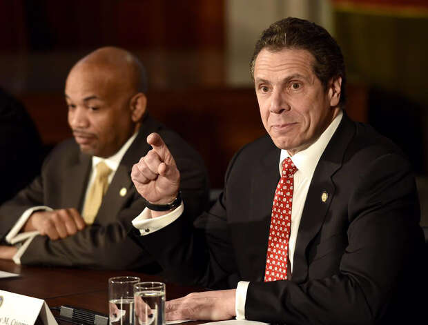 Gov. Andrew Cuomo speaks with Speaker Heastie, left, on an ethics reform initiative during a press conference at the Capitol Wednesday, March 18, 2015, in Albany, N.Y. (Skip Dickstein/Times Union)