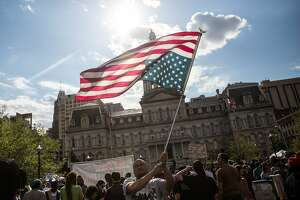 Thousands join 'victory rally' in Baltimore after charges filed - Photo