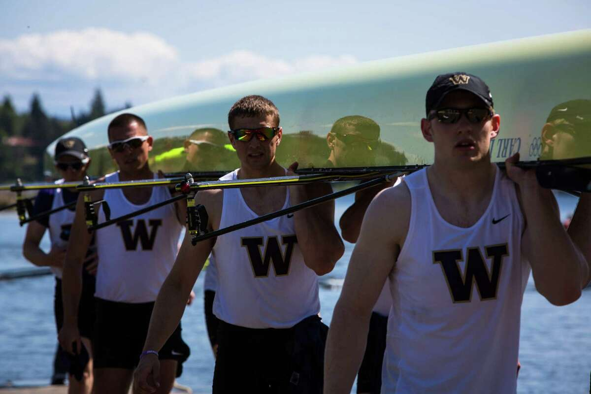 Members of the University of Washington Men's team haul away their boat after the annual Windermere Cup Regatta on Saturday, May 2, 2015. Hundreds gathered in the warm sunshine to watch the regatta and boat parade.