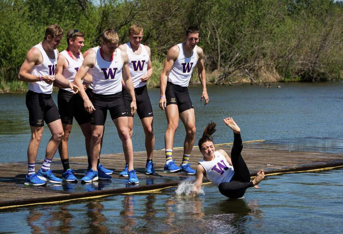 The University of Washington Men's team throws coxswain Lisa Caldwell into the water after after winning the Men's Erickson Cascade Cup during the annual Windermere Cup Regatta on Saturday, May 2, 2015. Hundreds gathered in the warm sunshine to watch the regatta and boat parade.