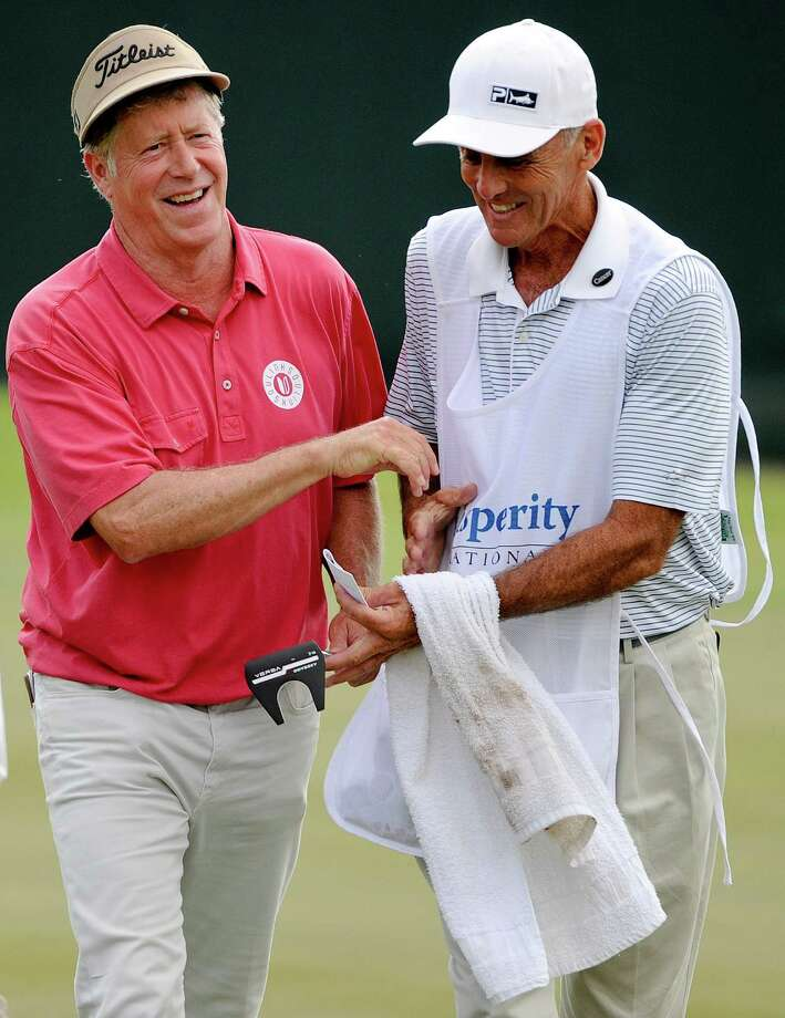 Michael Allen, left, and caddie Pete Bender are all smiles after Allen made a short birdie putt on No. 18 to earn the second-round lead Saturday. Photo: Eric Christian Smith, For The Chronicle / 2015 Eric Christian Smith