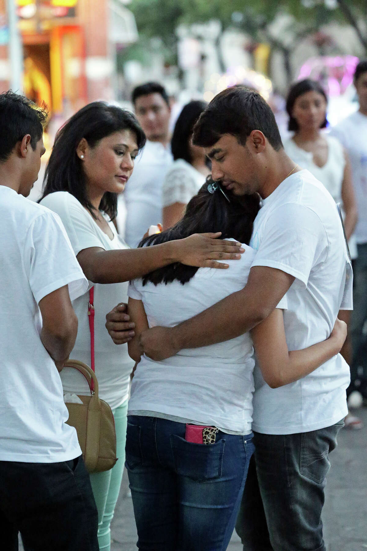 Sweta Sthapit, who lost her mother who was killed at home while eating lunch, is comforted by friends after trying to speak to the gathering as the Nepalese community in San Antonio gathers at Alamo Plaza to hold a candlelight vigil for the country of Nepal and earthquake victims on May 2, 2015.